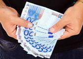 Man hands whith euro bills, studio shot — Stock Photo