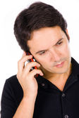 Young casual man on the phone, isolated on white — Stockfoto