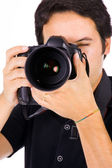 Close up portrait of a young photographer with camera at the stu — Foto Stock