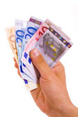 Man hand whith euro bills, isolated on white — Stock Photo
