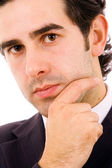 Close up portrait of a successful young business man. Isolated o — Stock Photo