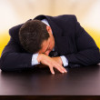 Tired mature business man sleeping on the desk at the office — Stock Photo #4174672