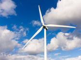 Wind turbine with blue sky as background — Stock Photo