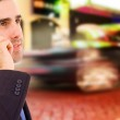 Young businessman talking on cellular phone at the street — Stock Photo
