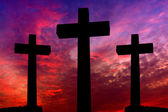 Crosses silhouette over a dramatic sky at sunset — Stock Photo