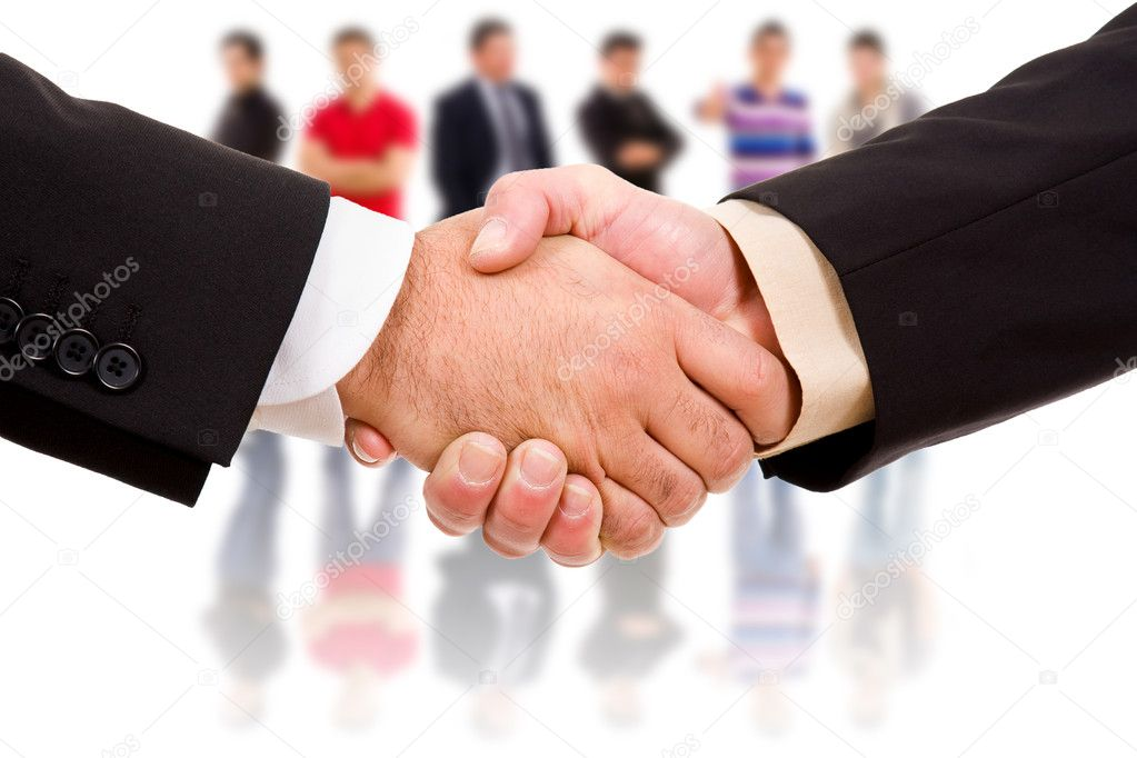 Closeup picture of businesspeople shaking hands, making an agreement.   Stock Photo #4625161