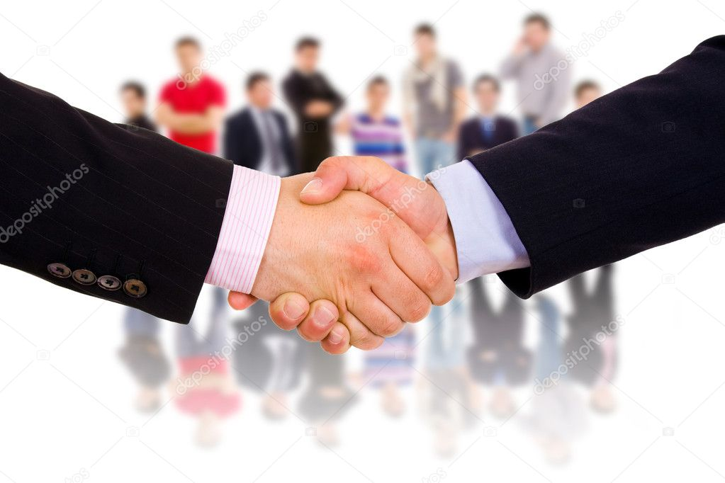 Business man hand shake with colleagues in the background. — Stock Photo #4640412