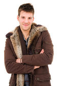 Picture of a young man dressed with winter clothes, isolated on — Stok fotoğraf