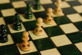 Pawns on chessboard — Stock Photo