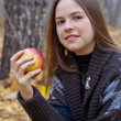 Portrait of brown-haired girl with apple — Stock Photo #4246190