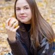 Portrait of brown-haired girl with apple — Stock Photo #4246194