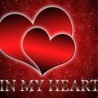 Foto Stock: Two hearts on red background