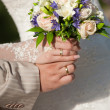 Wedding bands and hands - Stock Photo