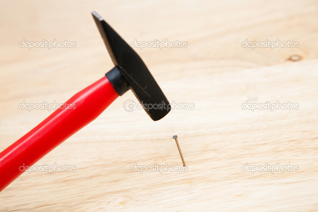 Hitting a nail in the head  Foto Stock #5045917