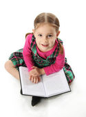 Preschool girl with book — Stock Photo