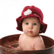 Baby girl sitting in a flower pot — Stock Photo #4433445