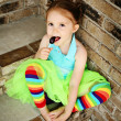 Preschool girl with tutu and candy sucker — Stock Photo