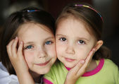 Kid sisters — Stock Photo