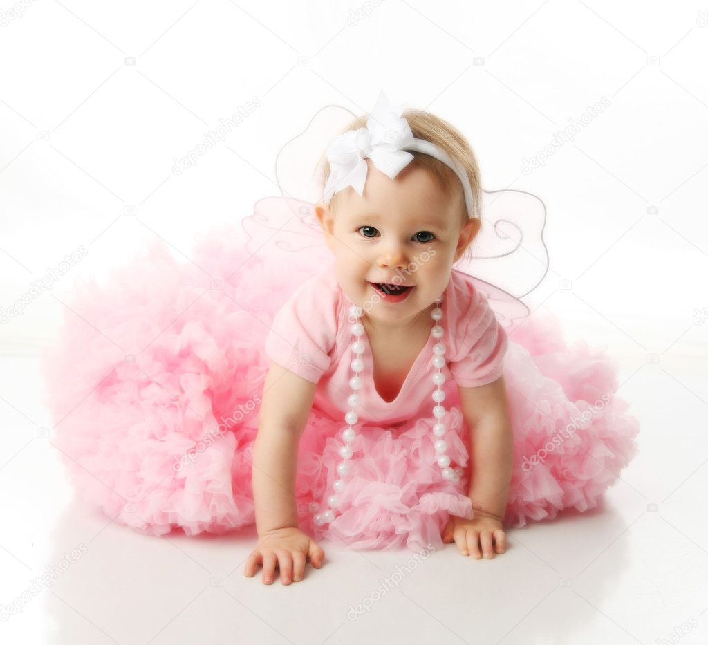 Portrait of a sweet infant wearing a pink tutu, necklace, and headband bow, isolated on white in studio — Stock Photo #4433551