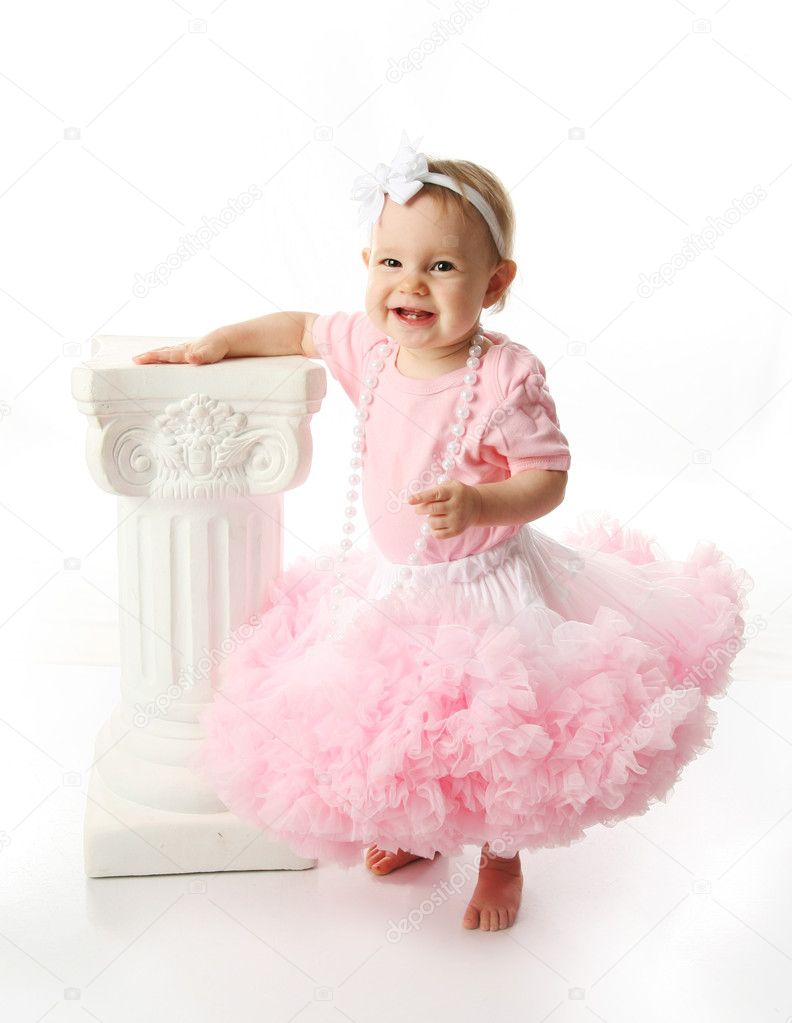 Draw baby tutus in with sets that are simpler, but expand out into wild pattern. A skirt is just as easily accompanied by a tank top, or a dress by a single headband. In either style, venture into playful pattern—boldly braving leopard spots or zebra stripes (since black and white offsets pink beautifully).