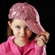 Royalty-Free Stock Photo: Female child wearing sparkly pink baseball cap