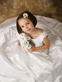 Little girl trying on mommy's wedding dress — Stock Photo