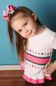 Little girl modeling hair bow and matching shirt — Stock Photo