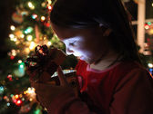 Little girl gets a magical Christmas gift — Stock Photo