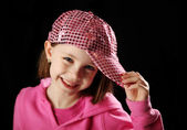 Female child wearing pink sparkly baseball cap — Stock Photo