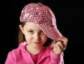 Female child wearing sparkly pink baseball cap — Stock Photo