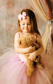 Little ballerina beauty hugging teddy bear — Stock Photo