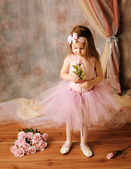 Little ballerina beauty holding a pink rose — Stock Photo
