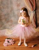Little ballerina beauty holding a pink rose — Stock Photo