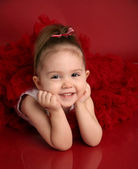Adorable little girl in red pettiskirt tutu — Stock Photo