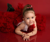 Adorable little girl in red pettiskirt tutu and black boots — Stock Photo