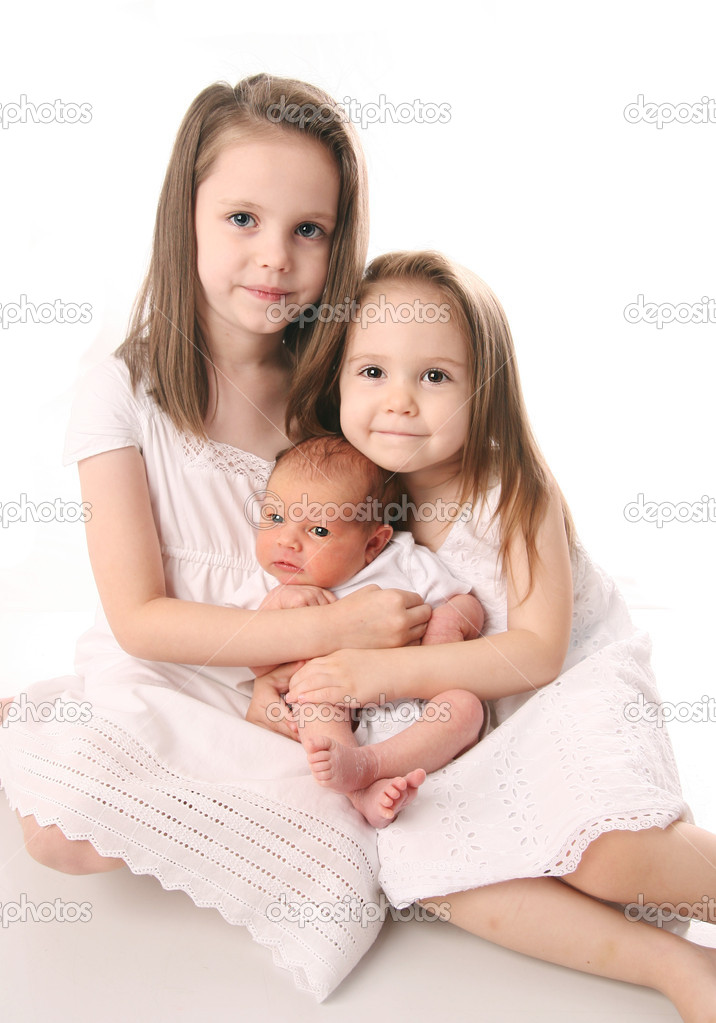 Two Girls With Newborn Sister Stock Photo C Teraberb