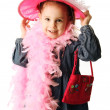 Preschool girl playing dress up - Stock Photo