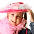 Funny preschool girl playing dress up - Stock Photo