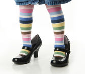 Little girl trying on mom's shoes — Stock Photo