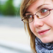 The young girl in glasses — Stock Photo