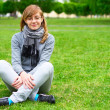 The girl sits on a grass — Stock Photo