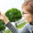 The girl holds a mobile phone in hands — Stock Photo #4165247