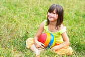 The child sits on a grass — Stock Photo