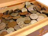 Old box with coins — Stockfoto