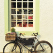 Bike Outside an Old-Fashioned Shop - Stock Photo