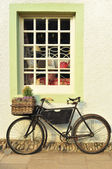 Bike Outside an Old-Fashioned Shop — Stock Photo