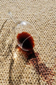 Wine spill on a wool carpet — Stock Photo