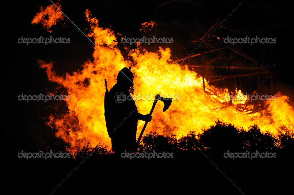 A Viking watches as a building burns. — Stock Photo #4654997