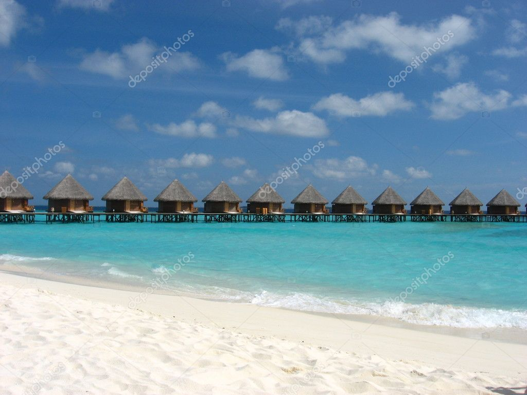 Water bungalow on the sea with amazing beach and sky — Stock Photo #4220545