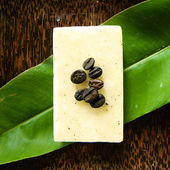 Natural soap with coffee beans — Stock Photo